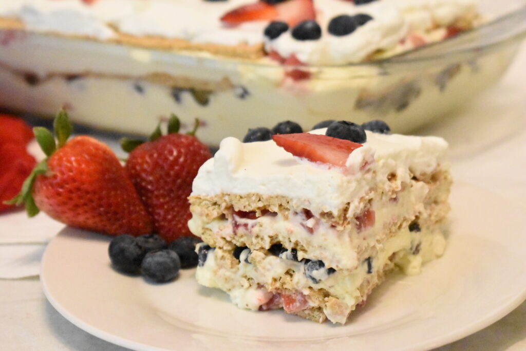 icebox cake made with blueberries and strawberries