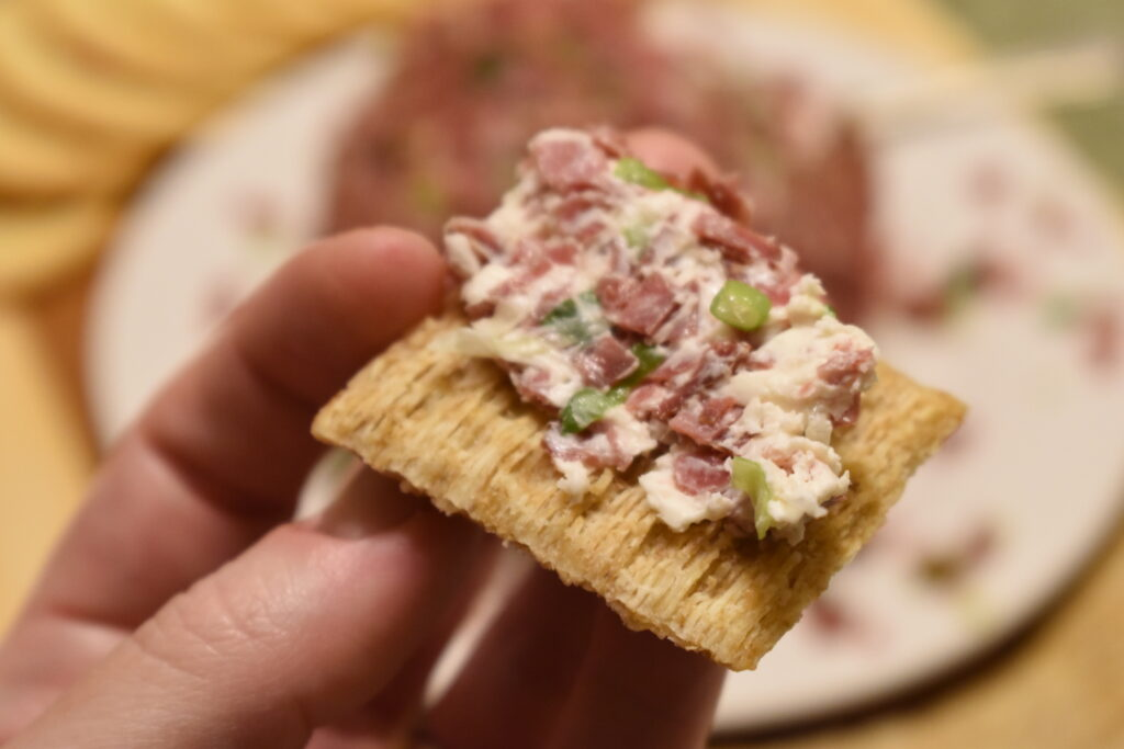 dried beef cheeseball on a cracker