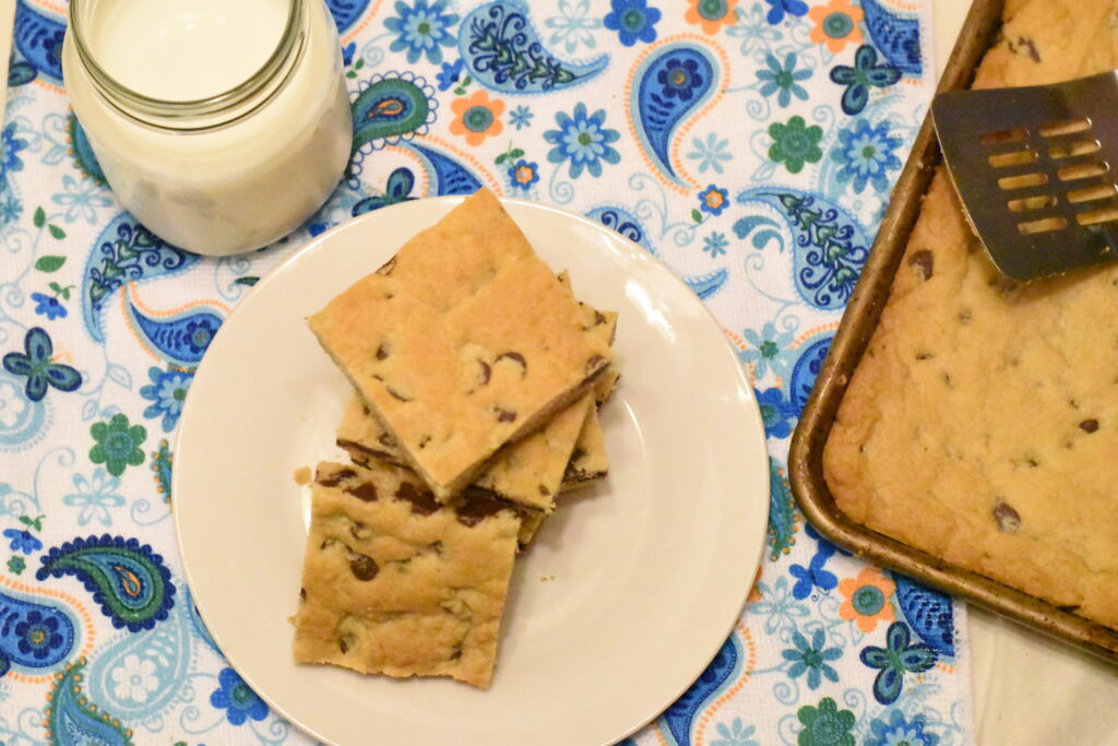 Plate and pan of chocolate chip cookie bars