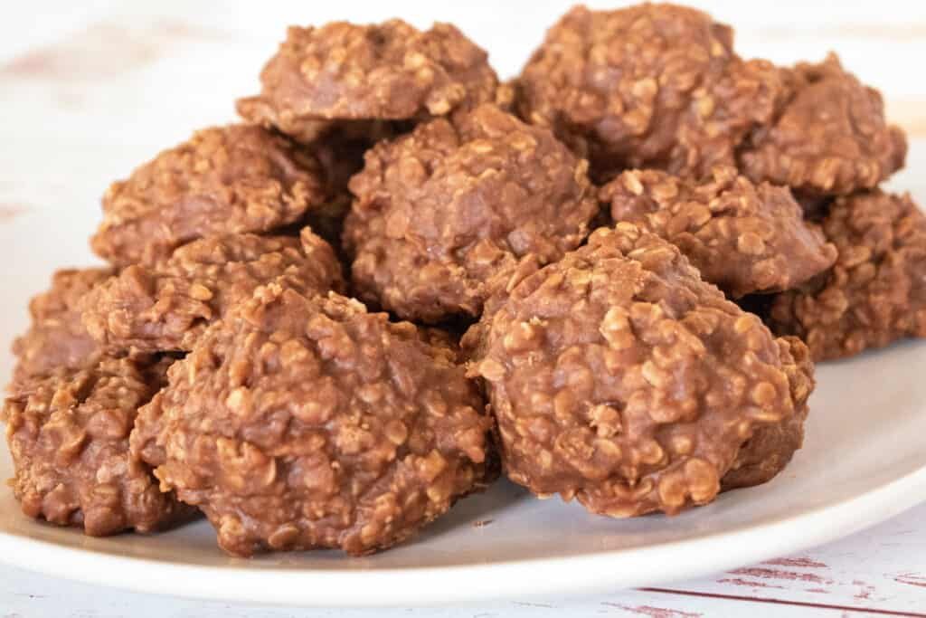 a pile of chocolate oatmeal no bake cookies on a white plate