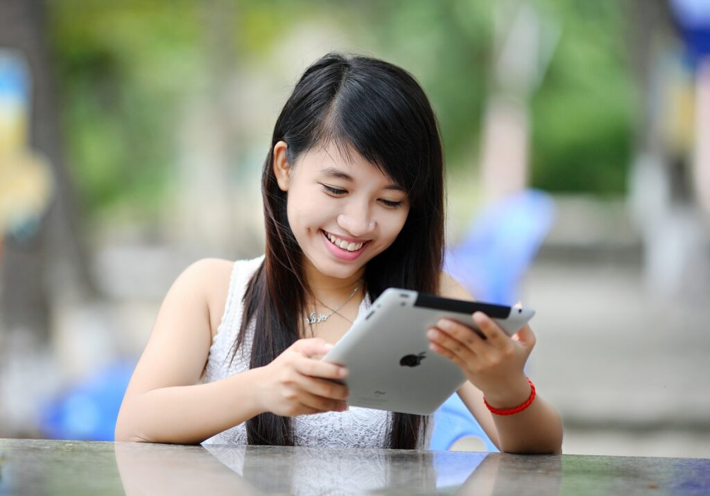 A young girl with an ipad