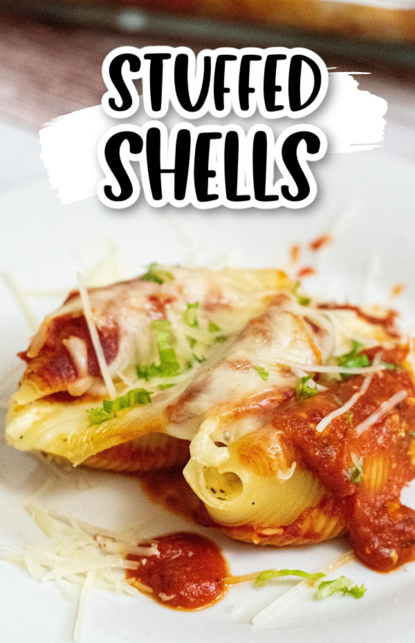 a white plate with 2 stuffed shells on it