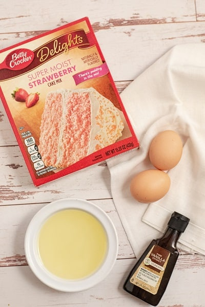 Ingredients for cake mix cookies, cake mix, eggs, oil and vanilla