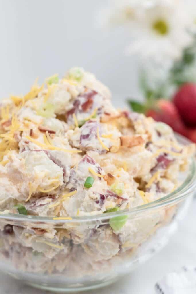A large glass bowl full of potato salad