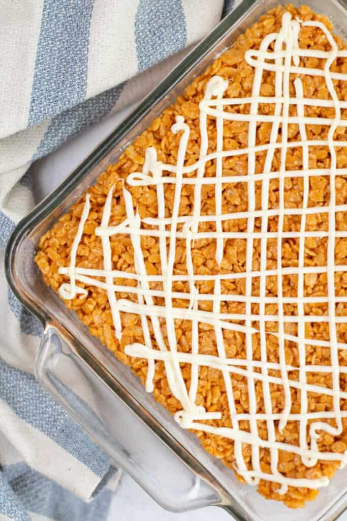 A glass pan full of pumpkin spice rice krispie treats