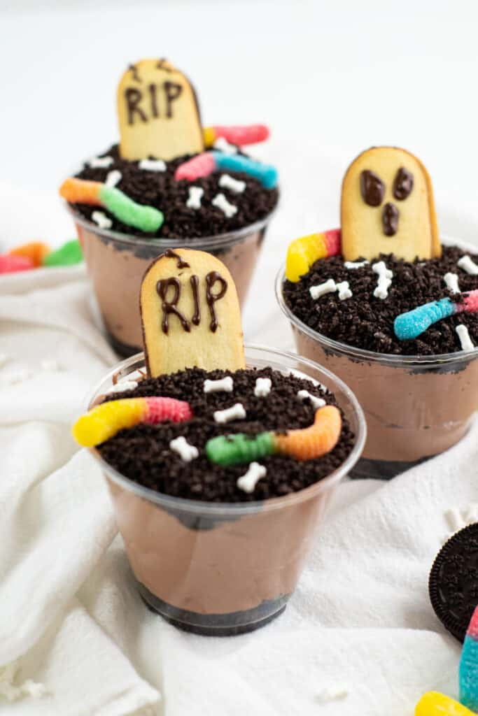 Three pudding dirt cups on a white background.