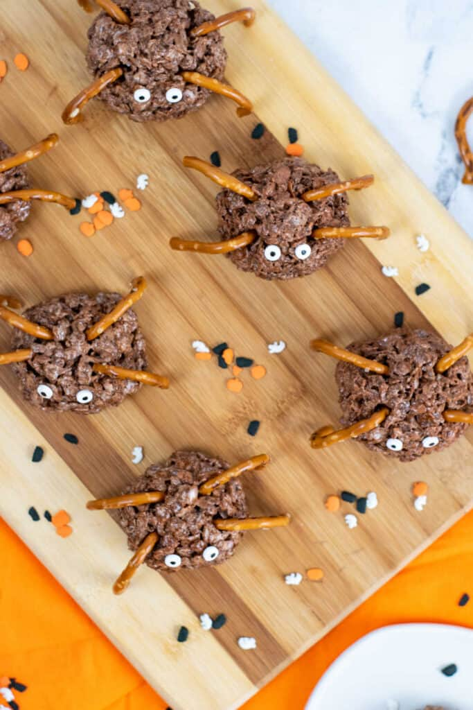 spider cereal treats lined up on a wooden background
